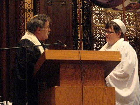 Rabbi Steve Chester passes the Torah to me (again) at ordination (5/18/08)