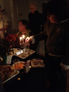 Lighting the Menorahs at the End of the Housewarming