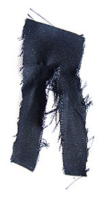 Kriah Ribbon: worn by a Jewish mourner to express grief