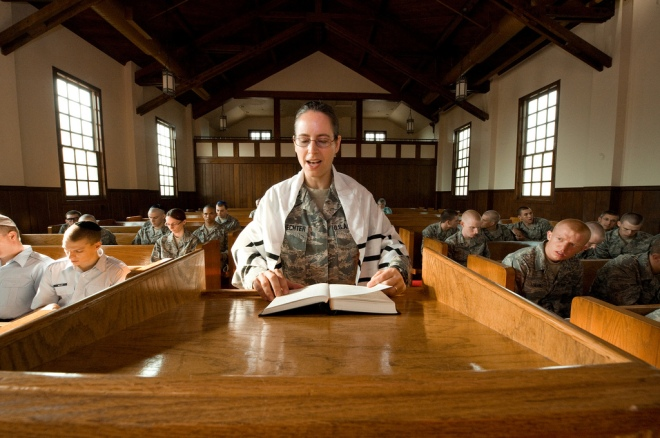 U.S. Air Force Rabbi, Chaplain, Captain Sarah D. Schechter leads the evening le'il shabbat service on Friday, Sept. 4, 2009 at Lackland Air Force Base's Airman Memorial Chapel. The more than 25 basic military trainees and other attendees participated in a religious education class, then Ma'ariv prayer service for the setting of the sun, followed by a meal provided by volunteers supporting the service. Because of training schedules some ceremonies and events are earlier than traditionally held. By order of commanders, those who want to attend any or all religious services of their choosing are given full permission and opportunity to do so.  Chaplain, Captain Schechter is an Operation Iraqi Freedom veteran and considers her deployment there to be one of the highlights of her career. Schechter was the first active duty female Rabbi in the Department of Defense. (U.S. Air Force photo/Lance Cheung)