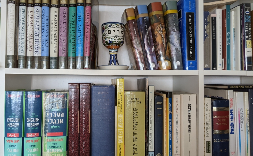 Books on Rabbi Adar's shelves.